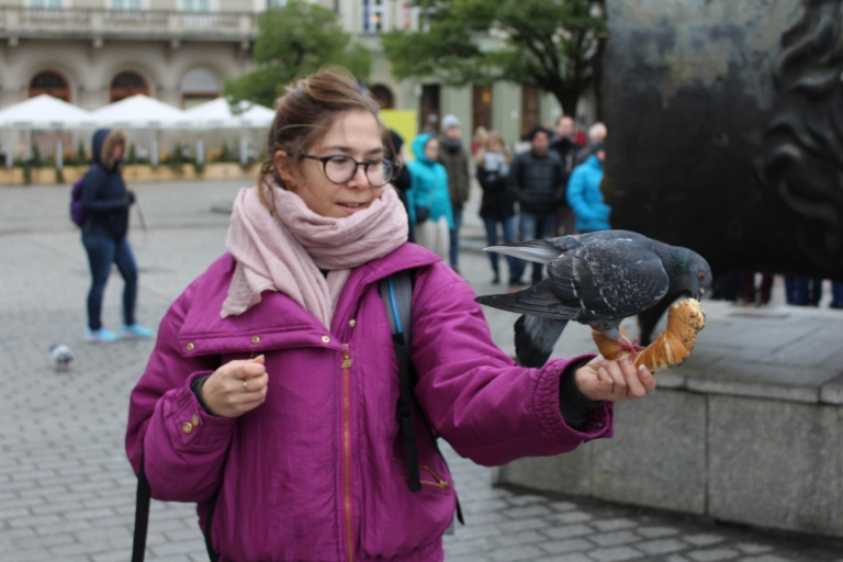 Feeding Pigeons in Krakow Main Square