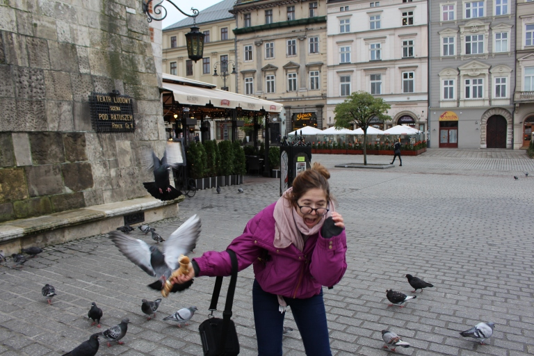 Feeding the pigeons in Krakow Main Square